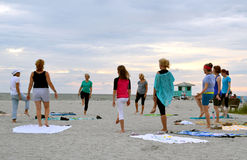 Exercising on the beach. Group exercising on the beach in the evening in Venice Florida Stock Photo