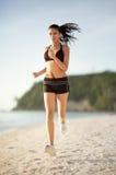 Exercising on the beach Stock Photo