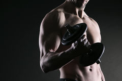 Exercising biceps with dumbbells Royalty Free Stock Images