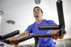 Exercising with bicycles in a gym stock photography