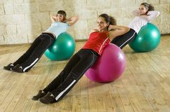 Exercising on big balls Royalty Free Stock Photo