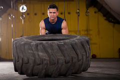 Exercising with a big tire Royalty Free Stock Photography