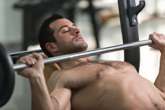 Exercising Chest With Barbell Stock Image
