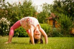 Exercising child Stock Image