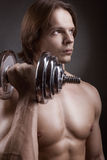 Exercising with dumbbell Stock Photo