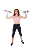 Exercising with dumbbell's. Royalty Free Stock Photos