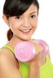 Exercising with dumbbells Stock Photography