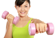 Exercising with dumbbells Royalty Free Stock Image