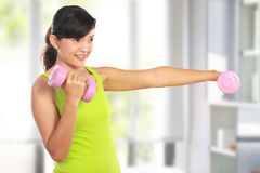 Exercising with dumbbells Royalty Free Stock Photo