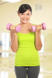 Exercising with dumbbells Stock Photos