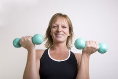 Exercising with dumbbells Royalty Free Stock Images
