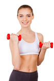 Exercising with dumbbells. Stock Photo