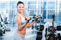 Exercising with dumbbells. Stock Images