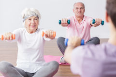Exercising with dumbbells Stock Images