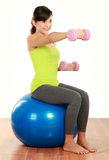 Exercising with dumbbells and pilates ball Stock Image