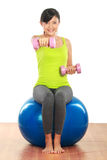 Exercising with dumbbells and pilates ball Royalty Free Stock Photo