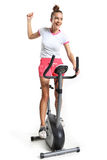 Exercising on exercise bike Stock Photography