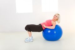 Exercising with fitness ball Royalty Free Stock Photo