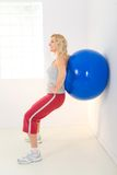 Exercising with fitness ball Royalty Free Stock Image
