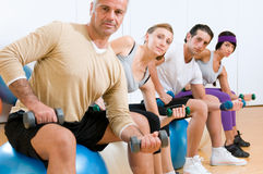Exercising with fitness ball at gym Stock Image