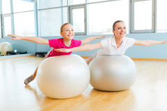 Exercising with fitness balls. Royalty Free Stock Images