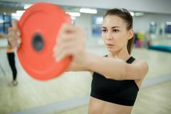 Exercising in fitness center Stock Images