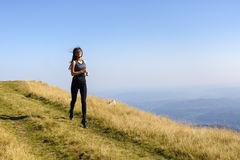 Exercising fitness woman doing exercises in nature. Girl doing m Royalty Free Stock Images
