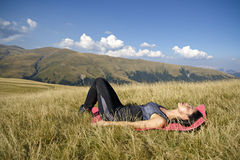 Exercising fitness woman doing exercises in nature. Girl doing m Royalty Free Stock Image