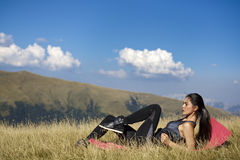 Exercising fitness woman doing exercises in nature. Girl doing m Stock Photo