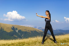 Exercising fitness woman doing exercises in nature. Girl doing m Stock Image