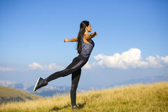 Exercising fitness woman doing exercises in nature. Girl doing m Royalty Free Stock Photography