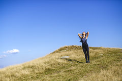 Exercising fitness woman doing exercises in nature. Girl doing m Stock Photography