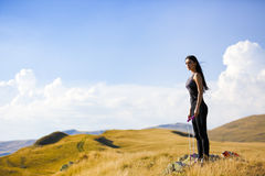 Exercising fitness woman doing exercises in nature. Girl doing m Royalty Free Stock Photos