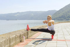 Exercising. Girl doing pose by the river Royalty Free Stock Images