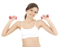 Exercising girl with small dumbbells Stock Photos