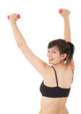 Exercising girl with small dumbbells Stock Image