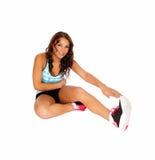 Exercising girl stretching. Royalty Free Stock Photos