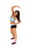 Exercising girl stretching. Stock Photo
