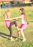 Exercising girls Stock Photography