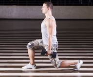 Exercising in the gym Stock Images