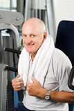 exercising gym man older Royaltyfri Fotografi