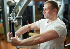 Exercising in gym Royalty Free Stock Images