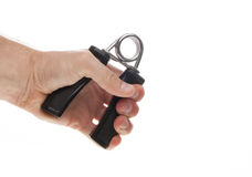 Exercising with a hand gripper. Stock Images