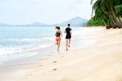 Exercising. Happy Couple Running On Beach. Sports, Fitness. Heal Stock Photo