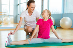 Exercising with instructor. Stock Image
