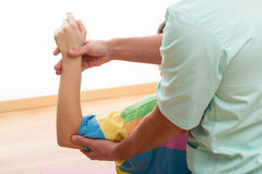 Exercising left arm Stock Photo