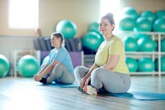 Exercising on mats royalty free stock image