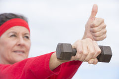 Exercising mature woman thumb up Royalty Free Stock Images