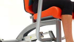 Exercising on modern hydraulic trainer close-up. On white background stock footage