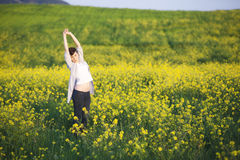 Exercising in nature. Young beautiful girl exercising on nature Royalty Free Stock Image